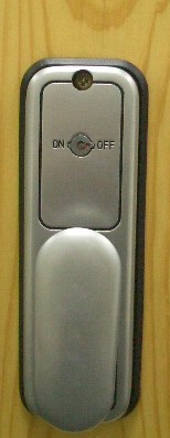 Turn the button to change code, no need to dismount the lock from the door to change code